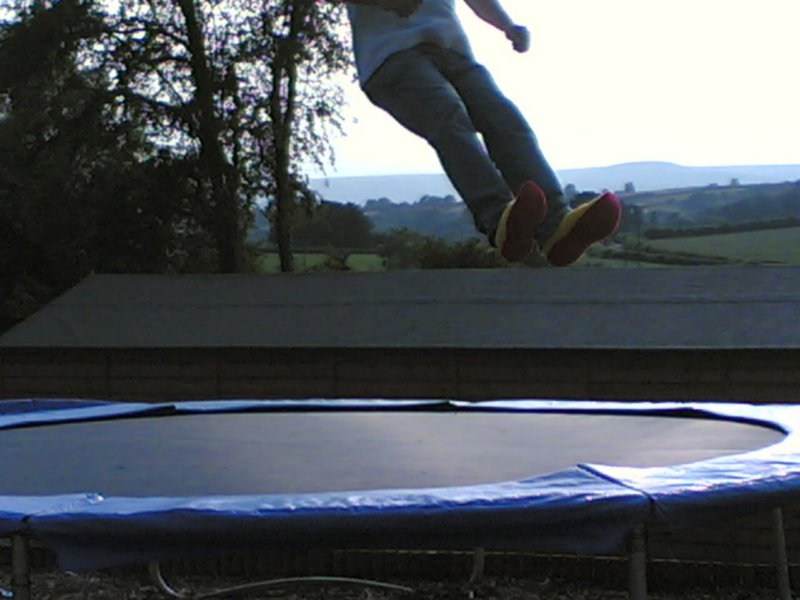 Pair of feet off the trampoline